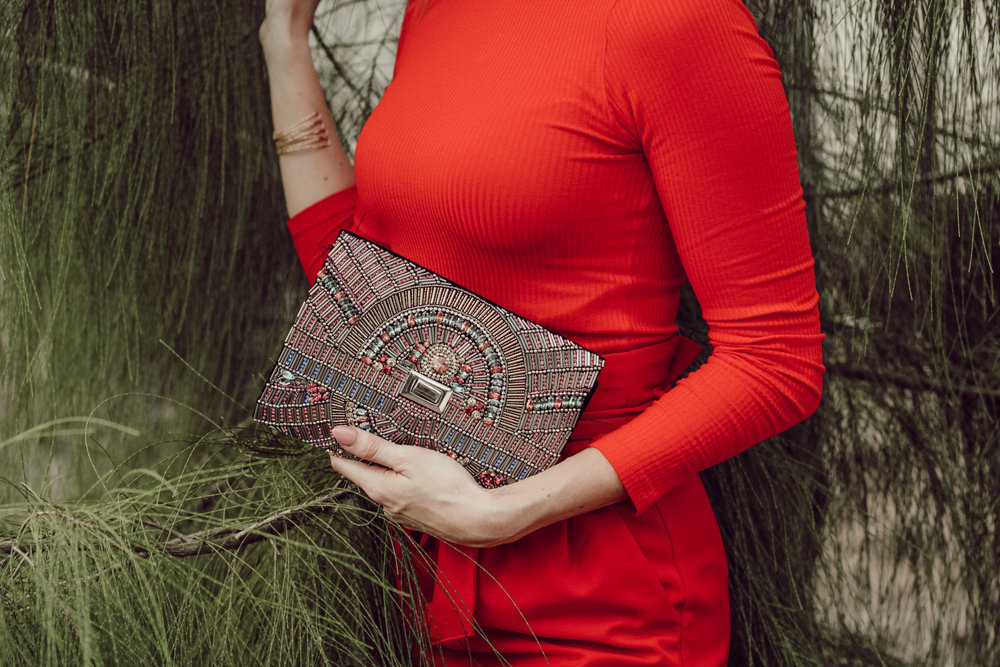 sequin clutch and red holiday outfit
