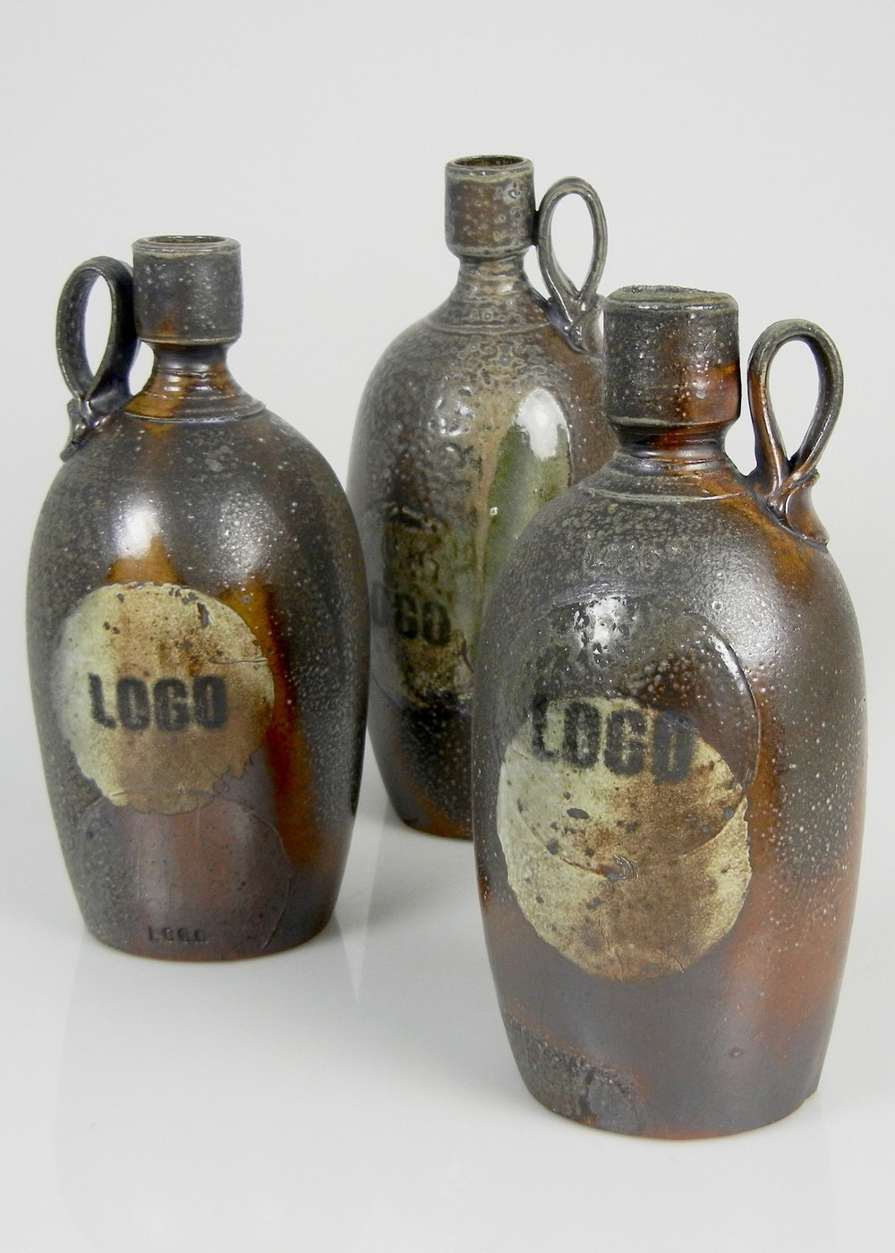 Lorenz Pottery, ceramics, pottery, folk pottery, wood fired, soda fired, jug, jugs, bottle, logo