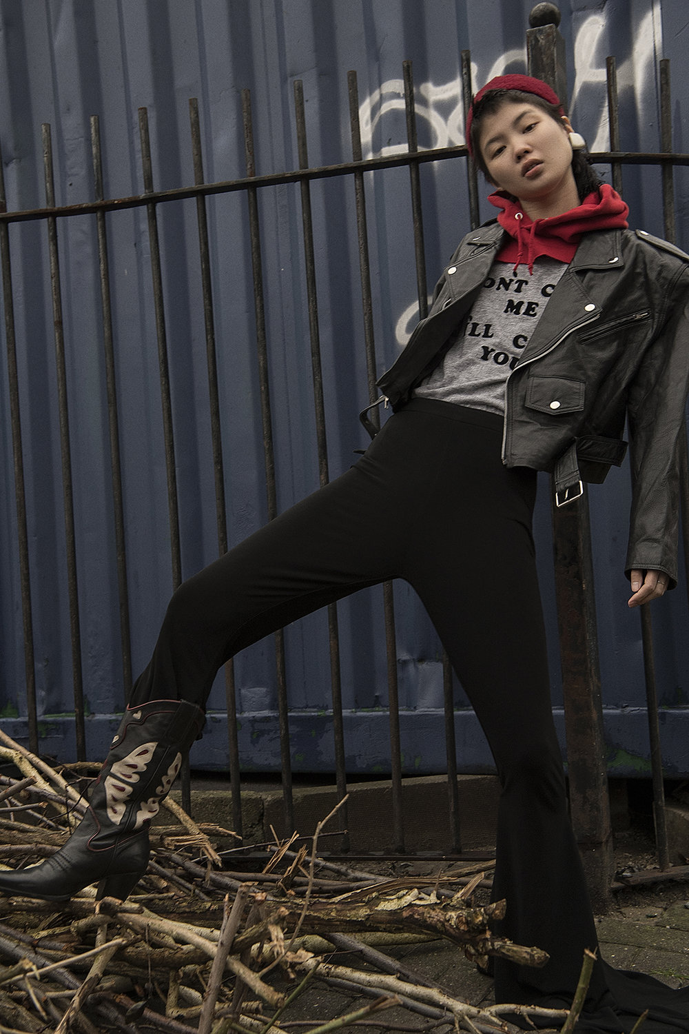 leather jacket + grey t-shirt  mint vintage  hat + earrings  the market cartel  red hood  stylist own  trousers + shoes  robert wun