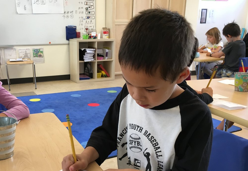 A first grader works on his creative project.