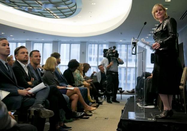 Photo: Associated Press. Leo DiCaprio second from left. Ellen Dorsey speaking. Justin Rockefeller in yellow tie.
