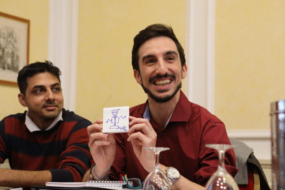 Massimo Gigliotti show his drawing of himself as a robot, with Martand Shardul looking on.  Photo Credits: Yuntong Man/SDSN Youth
