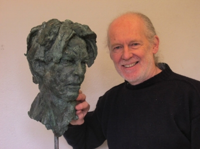 Stephen Hicklin with his sculpted head of David Bowie. Photo courtesy Ipswich Star
