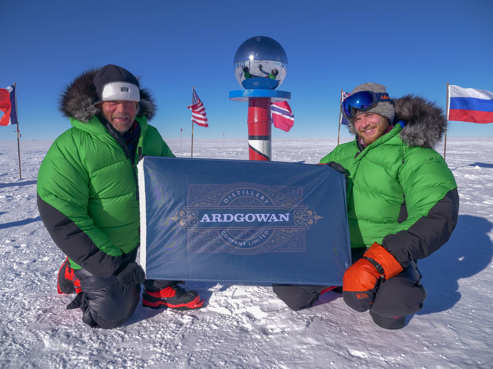 Barney and Robert at the geographic South Pole.