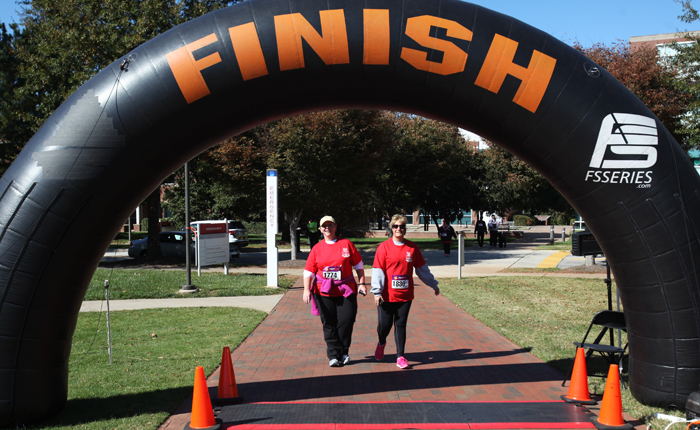 Faith and Lisa cross the finish line.
