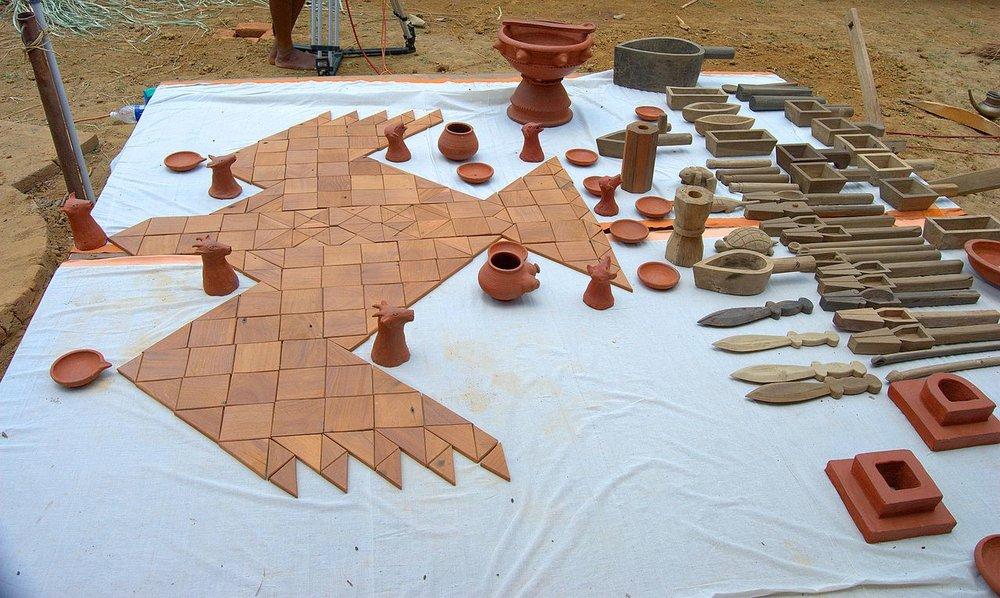 A miniature illustration of a falcon bird Athirathram yajna altar built using the square principle.jpg