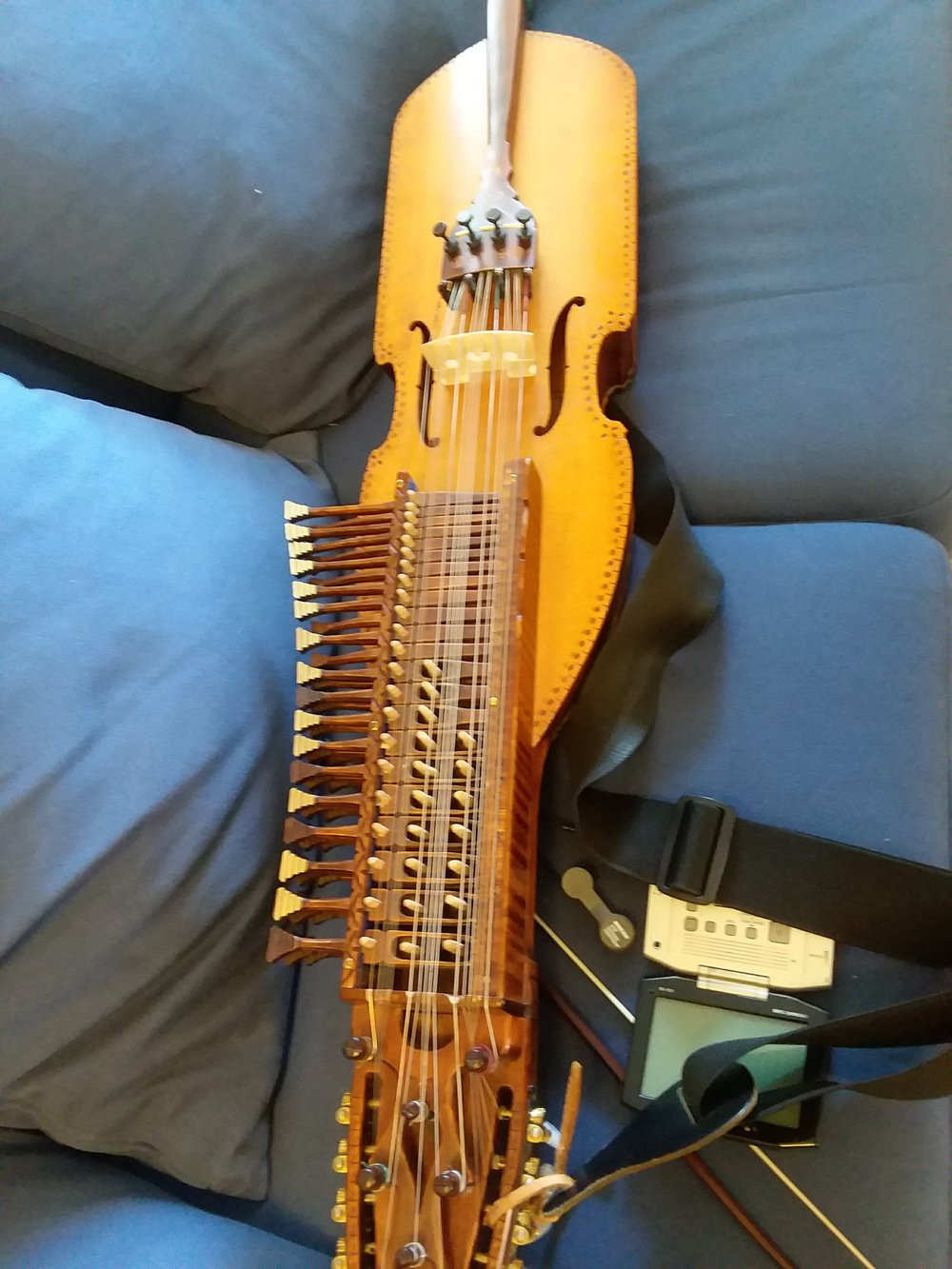 Olov's Nyckelharpa sitting on the couch while we set up for his interview.