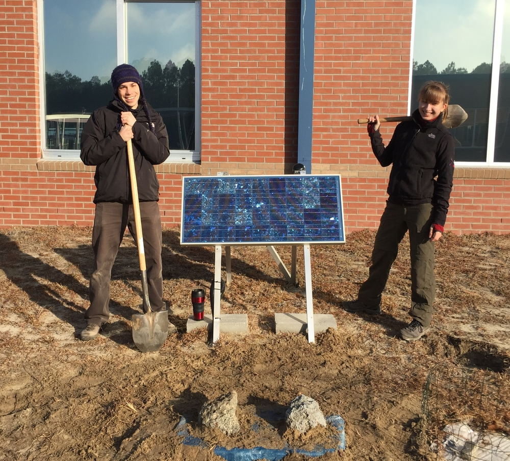 Servicing a seismic station in a school in Buxton, NC as part of the ENAM experiment. With Helen Janiszewski; photo credit: James Gibson.