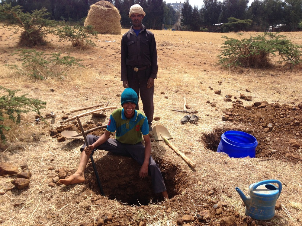 Installing a station in Mertule Mariam, Ethiopia, with the help of some local workmen.