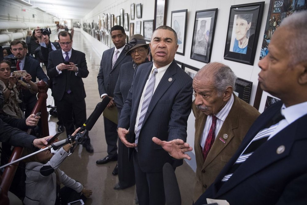 Rep. William Lacy Clay, D-Mo., center, and several other members of Congress speak to the media after a painting by a former constituent was re-hung in a Capitol passageway, after it had been removed several times by Rep. Duncan Hunter, R-Ca., and other Republican members of Congress.