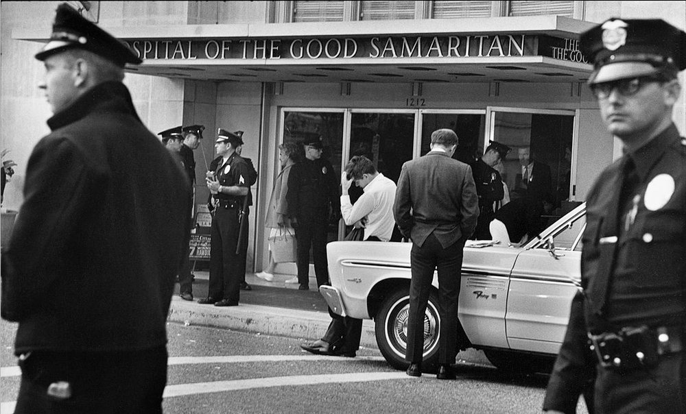 Hugh McDonald, in white shirt, a press assistant on the Robert Kennedy presidential campaign, outside the Hospital of the Good Samaritan in Los Angeles, June 5, 1968. Photo for LIFE magazine by Bill Eppridge.