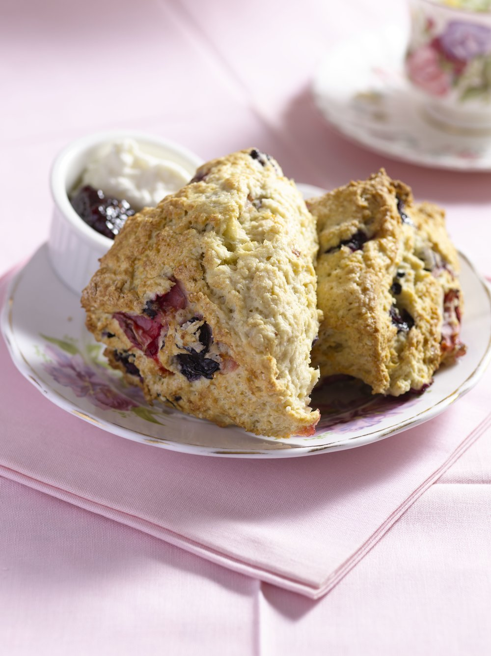 Mixed berry scones with homemade clotted cream and raspberry preserves