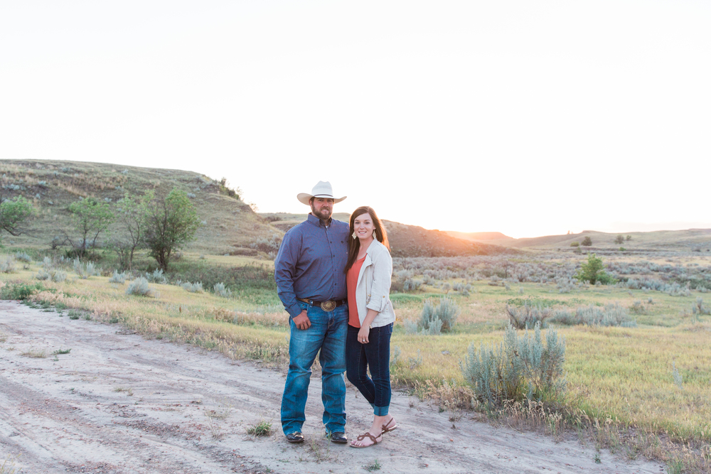 Katie & Travis invited me to their ranch in Western North Dakota last week for their engagement session. Because we live in North Dakota, the wind was blowing like crazy, naturally. After a few location stops and some good luck, we were able to find a few spots where the wind was blocked.