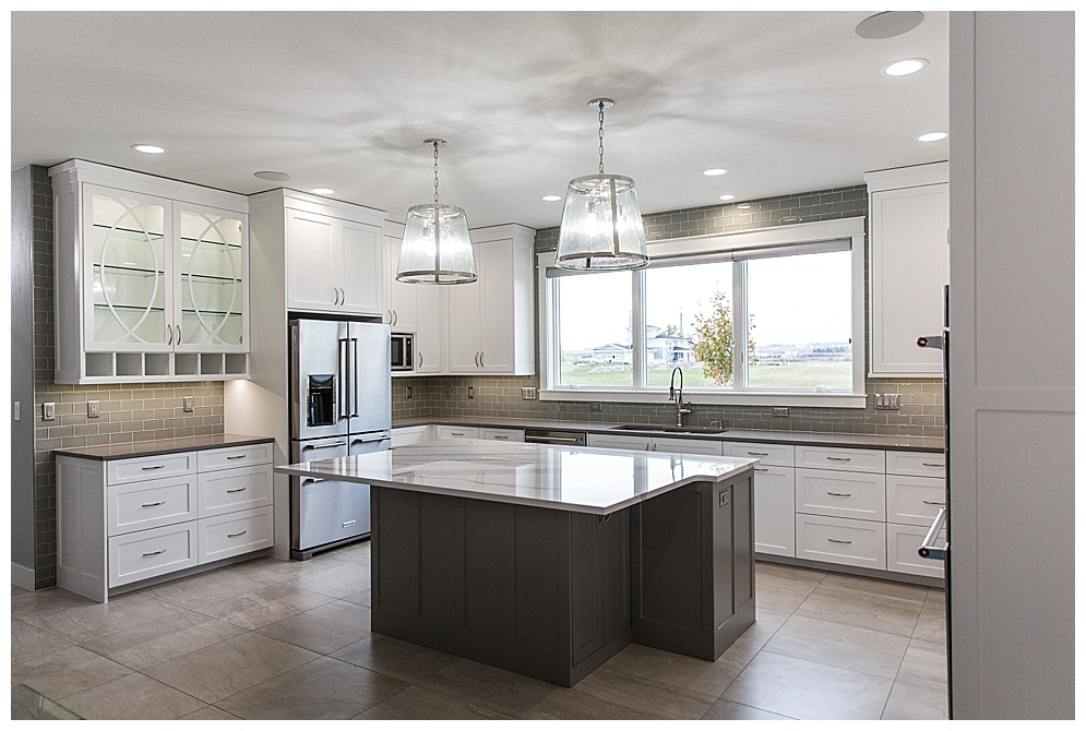 This beautiful Prestige Home is located on Dream Drive in north Bismarck along the shores of Misty Waters. How fitting of a street name, as this home is most definitely a dream!