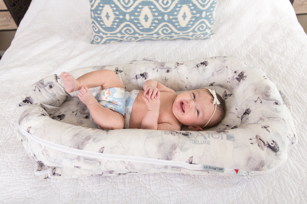 Last but certainly not least, my favorite product and hands down the number one product for any new parent is the  DockATot . This amazing little thing is wonderful. It fits snug between my husband and I so Bristol is able to co-sleep with us. It has built up sidewalls, all made out of a breathable mattress, so that we are not able to roll onto her and she can't roll out. It's extremely lightweight and much smaller then a pack-and-play so it is our go-to for traveling to and from our ranch. I also love the washable, interchangeable cover. For more designs and product info click  HERE !