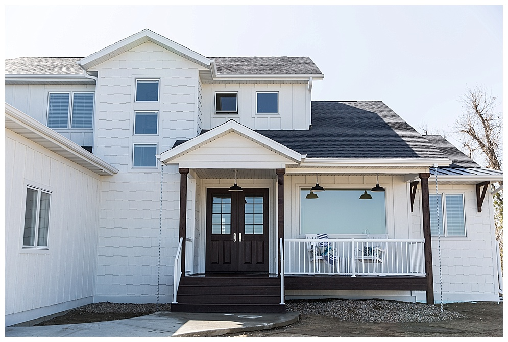 Located in South Bismarck, this charming farm style home was featured in the Spring 2018 Bismarck-Mandan Parade of Homes tour. I personally love a bright white kitchen and was drawn to the beautiful living room chandler. This home also featured unique bathroom tiles and a custom floor plan designed by Big River Builders. Check out more of there homes  here!