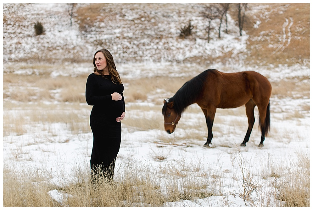 I joined Sarah at her home south of Glen Ullin this winter to document her pregnancy. We were joined by not only her husband, but a dog and a horse :) She was a champ outside in the freezing cold, rocking one of my maternity photography dresses.