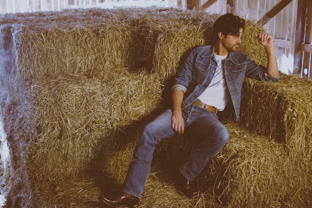 sitting in the hay.jpg