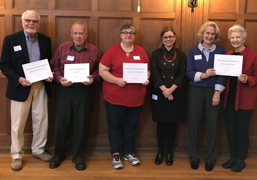 Pictured from left to right:  Bob Scarponi from Canterbury Historical Society, Roger Daniels from Rumney Historical Society, Lynn Clark from Hopkinton Historical Society, AHSNH award committee chair Jennifer Carroll, and Christie Winmill and Paula Schwenk of Walpole Historical Society