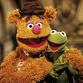 The only thing that could make Kermit and Fozzie THIS happy is giving...