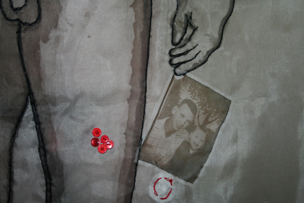 Detail of photograph (a digital print on silk-organza) sewn to fabric background.
