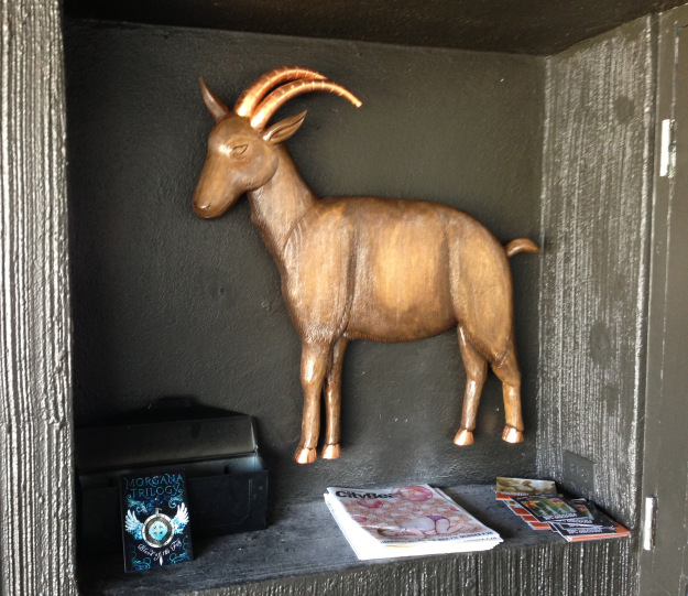 …and here is the goat installed at the front door to the restaurant, at home in his little niche guarding the mail and greeting customers.