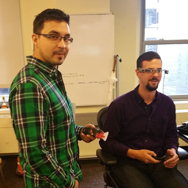 Just another day at Clarity: a guy with a robotic fish talking with a guy wearing augmented reality glasses
