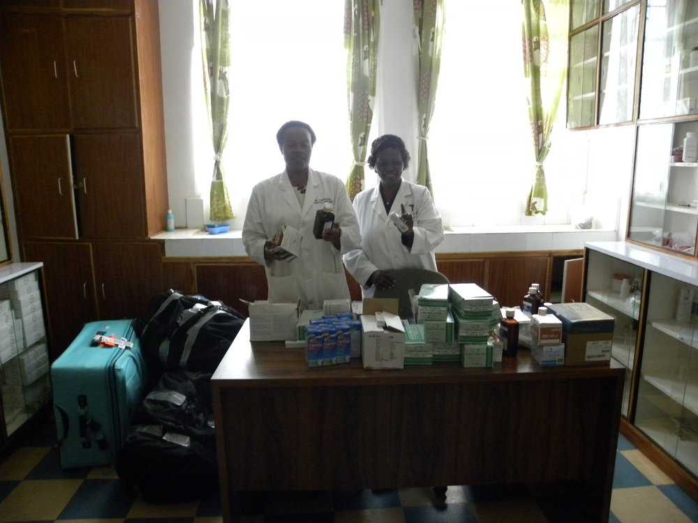 Nurses in the clinic office with the gloves donation.