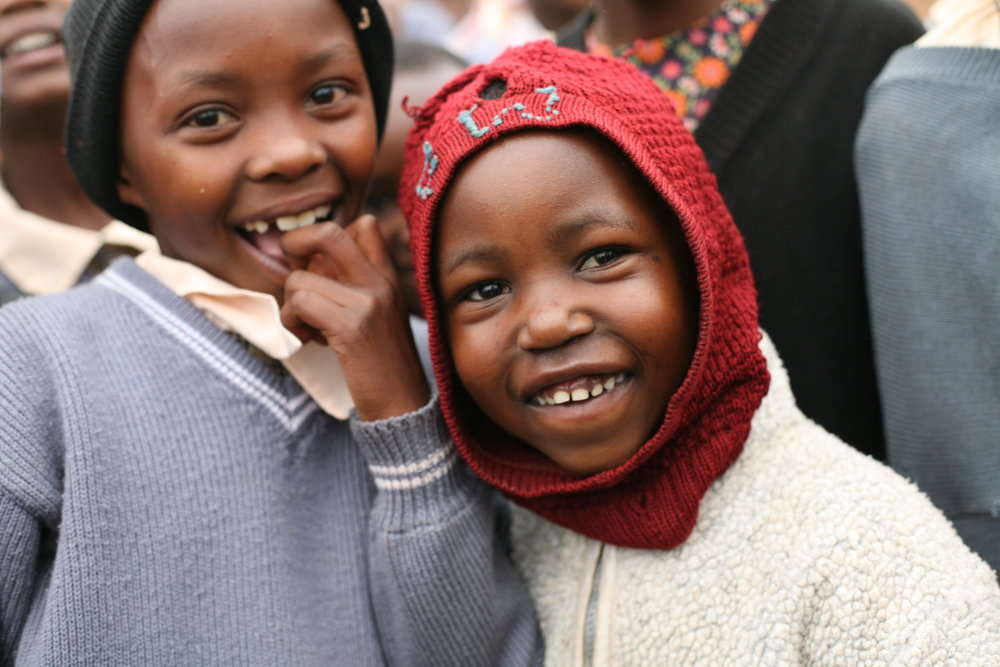 Two beautiful smiles of children at Tumaini.