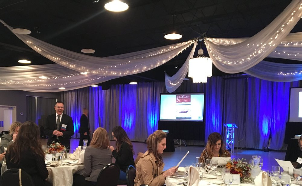 Corporate Banquet With Blue Lighting and Presentation