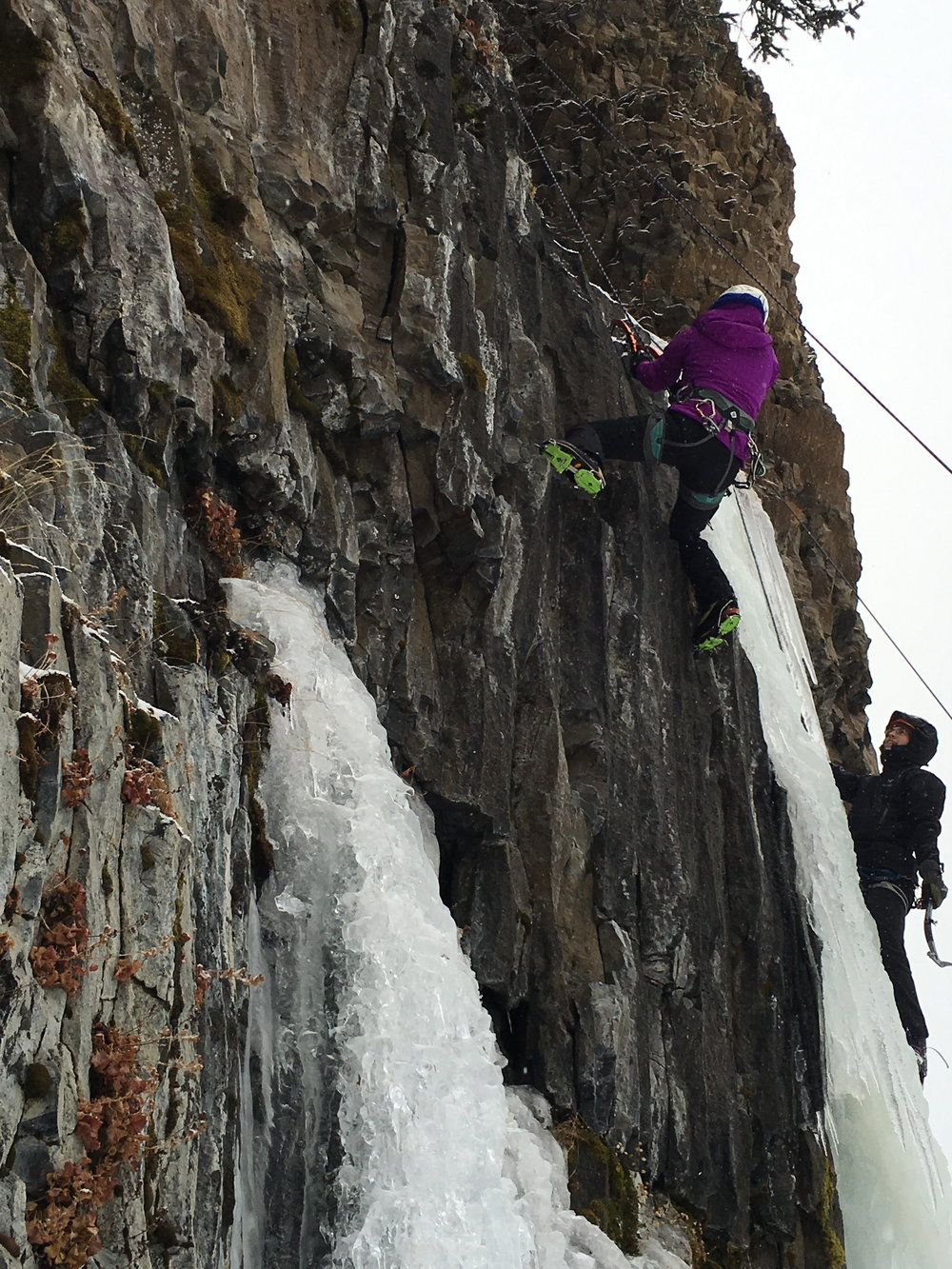 Lisa climbing a mixed line during the Bozeman Ice Fest.