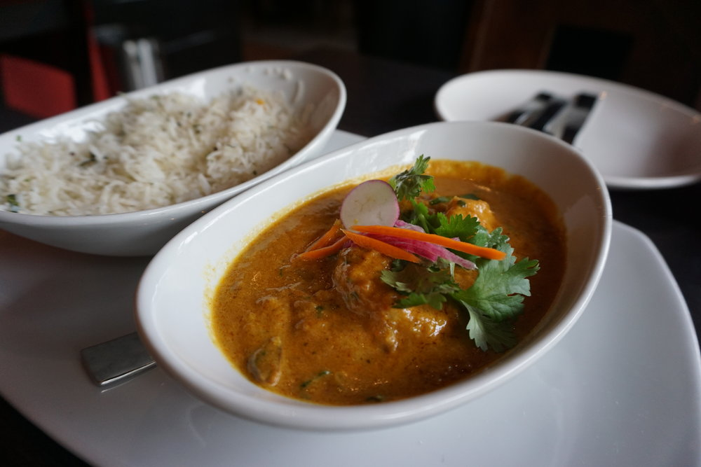 Malabar Shrimp Masala: Gulf shrimp prepared with onions, fresh chilies and our coriander masala blend, served with coconut rice