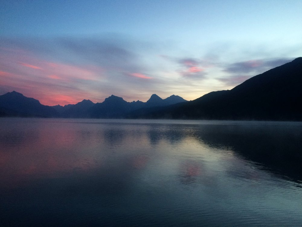 Sunrise over Lake McDonald in East Glacier. Don't forget your thermos of coffee and a blanket!