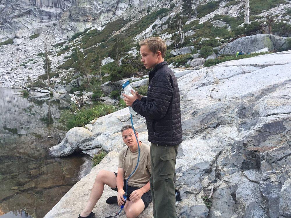 Nathaniel and Ian filtering water, Hamilton Lake