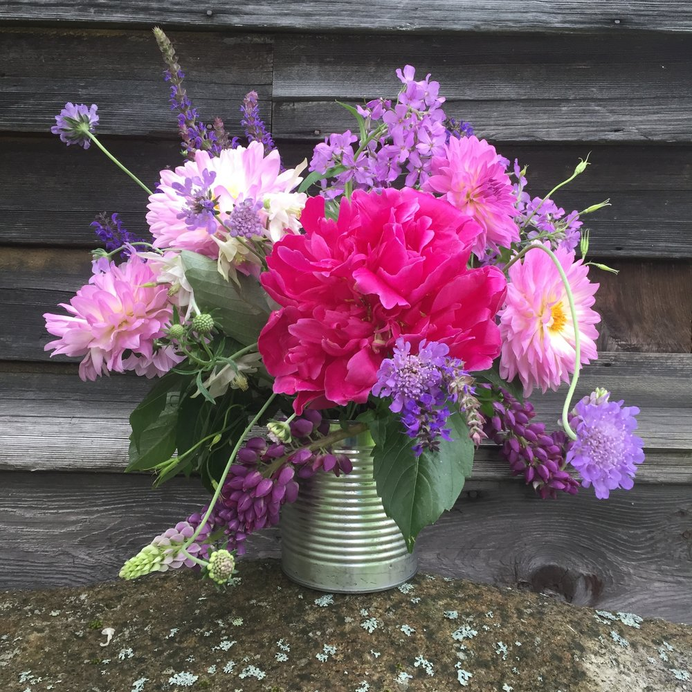 An early summer arrangement with peonies and lupines and some dahlias from a friend.