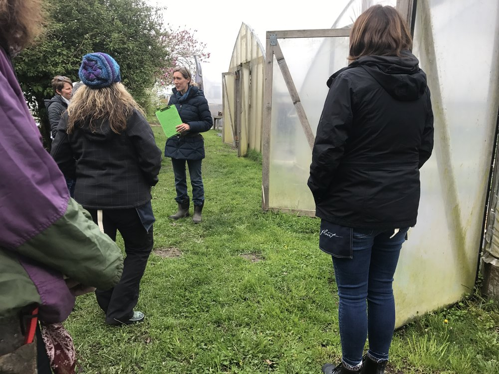 Erin Benzakein leads a tour of Floret Flower Farm for workshop attendees.