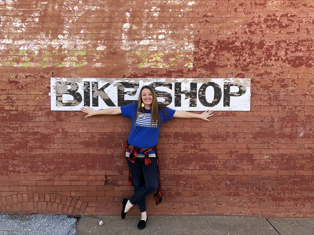 Courtney on bike shop wall.