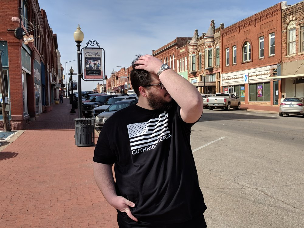 jeffery standing in downtown guthrie oklahoma.jpg
