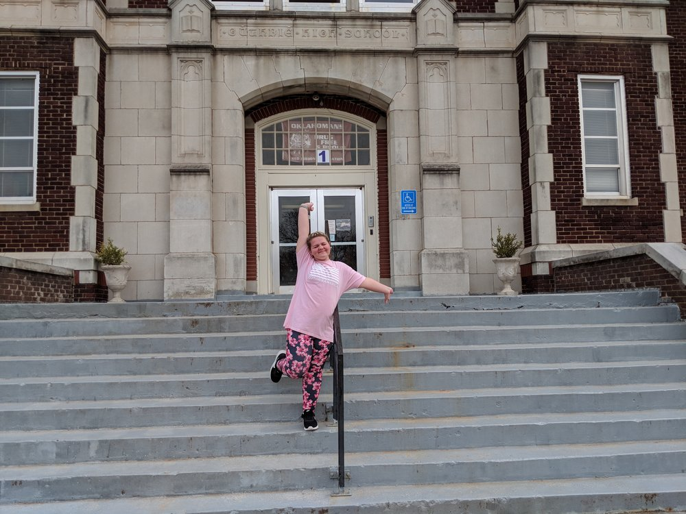 Peyton hanging out at Guthrie Jr. High on steps.