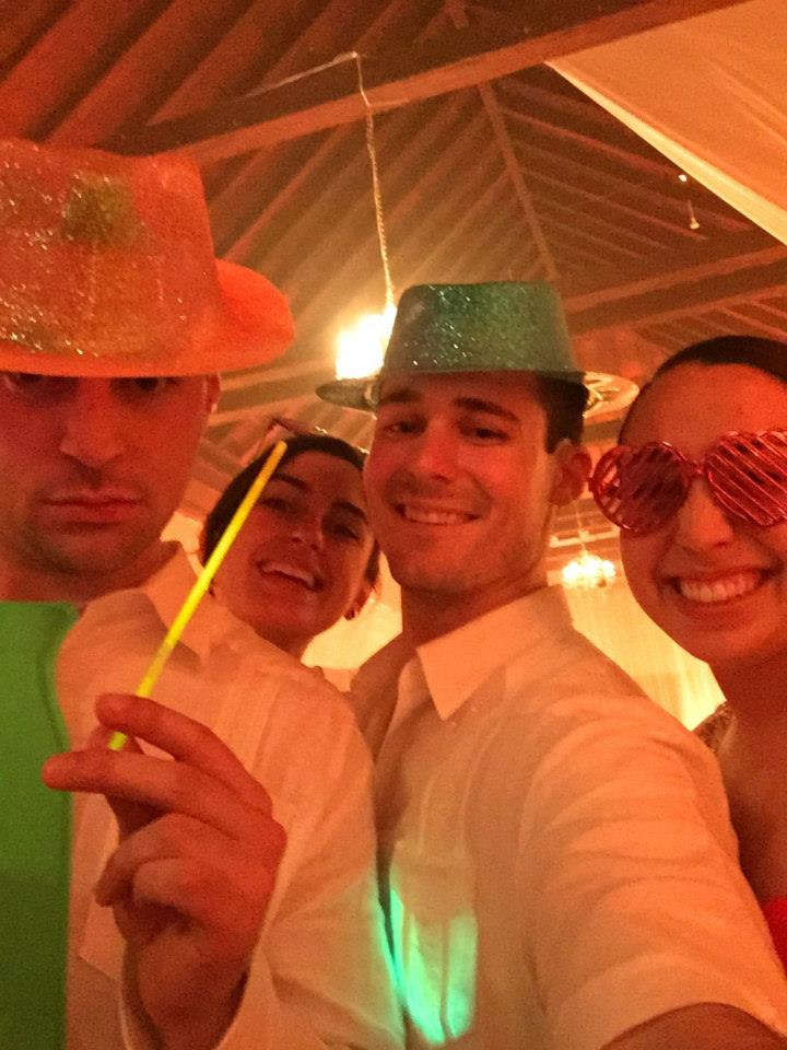 """All Colombian weddings have a themed """"Crazy Hour"""". This wedding had a Carnaval Troupe perform during the reception (around 3AM). They sang and danced, and brought party favors and glow sticks to liven things up!"""
