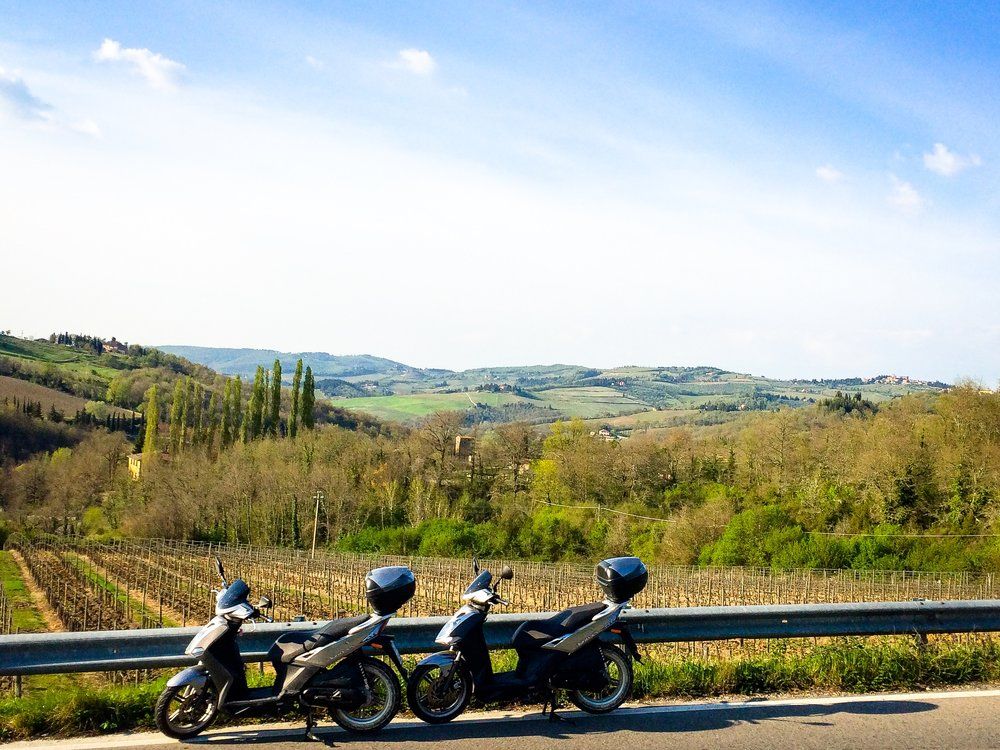 What's more romantic than going touring through Tuscany's vineyards with your bestie on a vespa?