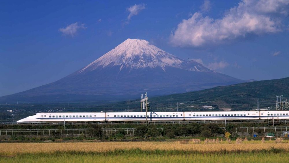 Mount Fuji with a Japanese 'Bullet Train' in the foreground.