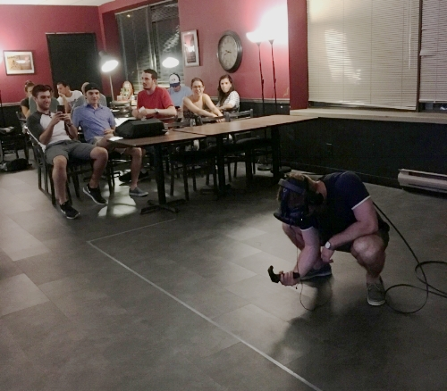Spectators watch a player experience VR at Escape Games Canada