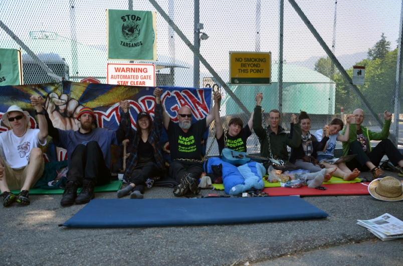 pipeline protest chained - Burnaby Now.jpg