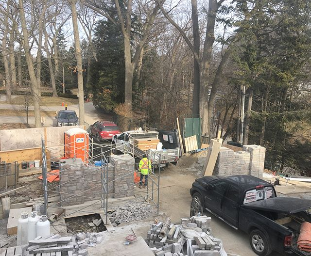 The best part of every winter job is taking down the hoarding and seeing the finished product! These two front entry walls will hold the cantilevered gate to maximize the driveway space. Once the custom Indiana Limestone caps are installed this entrance will definitely stand out! #construction #landscaping #landscapingthe6ix #custom #highend #toronto #stonework #granite #stonemason