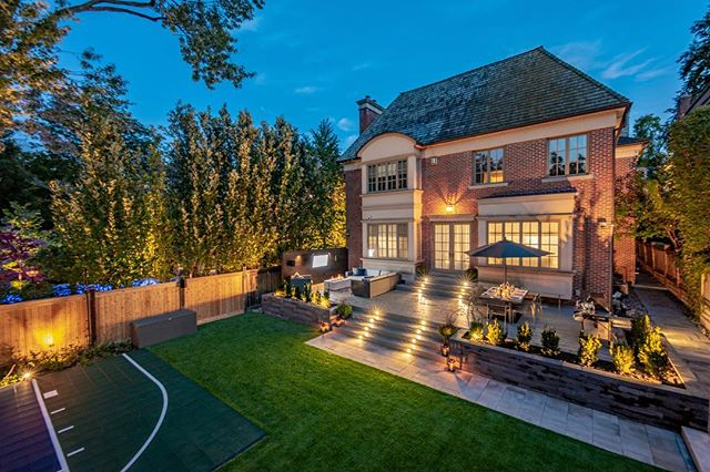 Shots like this of our Forest Hill project we completed last year make us excited to start some beautiful landscapes for this season! Now, if only, the weather would cooperate... This beautiful back yard features a large open deck fully equipped with a fire pit and outdoor tv that transitions into the lower artificial turf and sport court area. Looking forward to creating more like this in 2019! . . . . .  #construction #landscaping #landscapingthe6ix #highend #custom #toronto #landscapelighting #woodwork