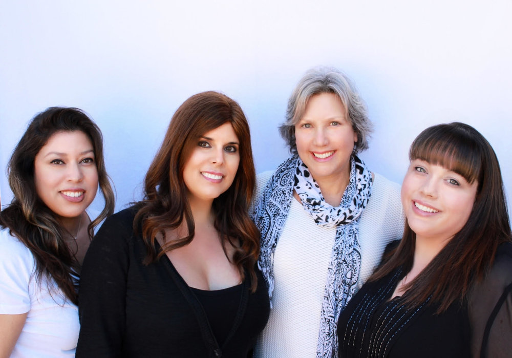 L. to R. Deb: Manager - Customer Service, Lauren: V.P. Operations, Lizzy James: Founder, Trish: Manager - Production