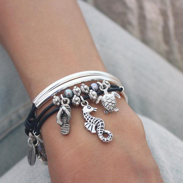 This  Mini Charmer with Nautical Charm Trio  wrap bracelet comes with the  Seahorse ,  Flip Flop Sandal  and  Turtle  charms attached.