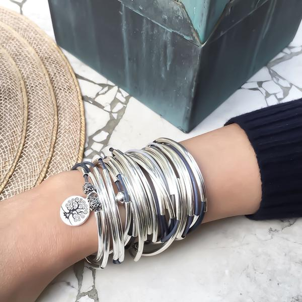 The April with Tree of Life charm  looks great layered with other wrap bracelets like this  Lizzy Classic 5 Strand in Blueberry !