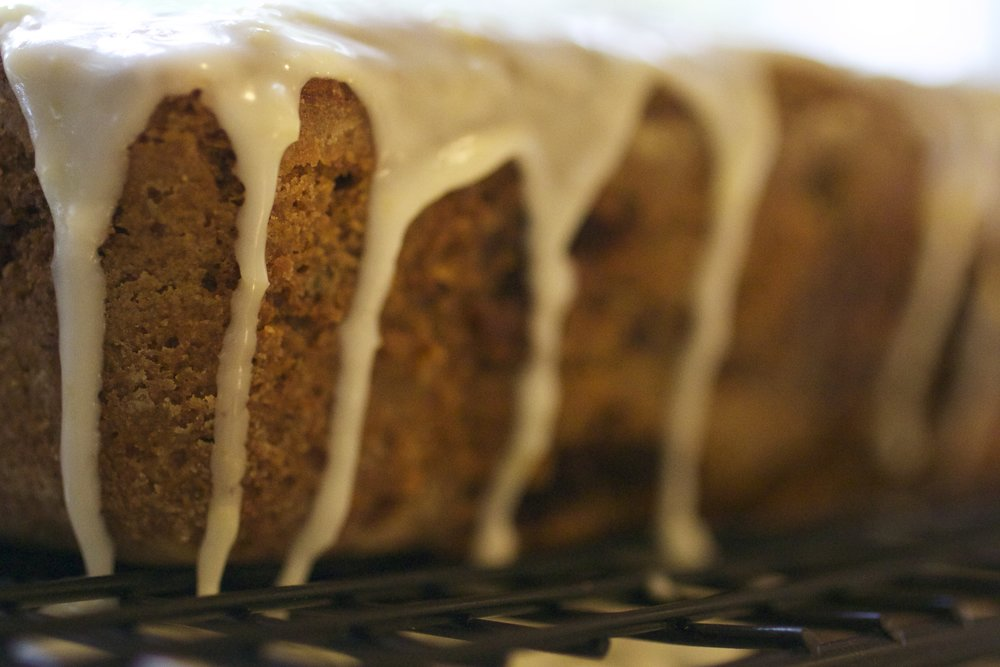 Lemon Icing dripping down freshly baked zucchini bread.